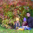 Happy family in autumn park outdoors — Stock Photo #56089063