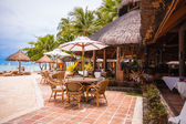 Outdoor cafe on tropical beach — Stock Photo