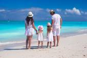 Back view of young beautiful family during tropical beach — Stock Photo