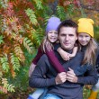 Happy family in autumn park outdoors — Stock Photo #56091761