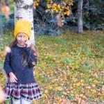 Little girl in autumn park outdoors — Stock Photo #56091939