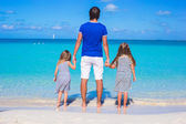 Father and his two kids walking by the sea — Stock Photo
