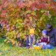 Happy family in autumn park outdoors — Stock Photo #56602297