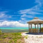 Traditional Caribbean arbor on shore — Stock Photo #56602671