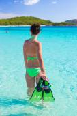 Young woman with snorkeling gear on tropical beach — Stock Photo