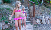 Two adorable little girls in swimsuits during the summer holidays — Stock Photo