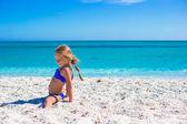 Adorable little sporty girl on white tropical beach — Stock Photo