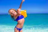 Little adorable girl playing with beach toys during vacation — Stockfoto