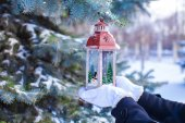 Christmas lantern on fir branch in snow winter day — ストック写真