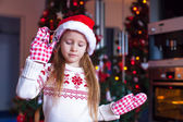 Adorable little girl baking gingerbread cookies for Christmas — Foto de Stock