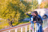 Father and cute daughter in autumn park outdoors — Foto Stock