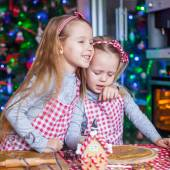 Cute little girls preparing gingerbread cookies for Christmas — Stock Photo