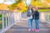 Adorable little girls at warm autumn day outdoors — Stock Photo