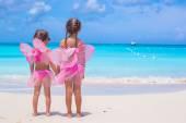 Little girls having fun during tropical beach vacation — Stock Photo