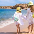Adorable cute girls have fun on white beach during vacation — Stock Photo #62196623