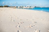 Human footprints on white sand of the Caribbean island — Stock Photo