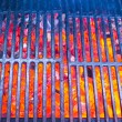 Empty black cast iron grill with hot red glowing coals — Stock Photo #62660829