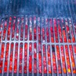 Empty black cast iron grill with hot red glowing coals — Stock Photo #62660837