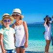 Happy family with two kids during tropical beach vacation — Stock Photo #62662825