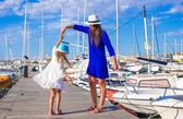 Young mother and little girl in port during summer vacation — Stock Photo