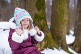 Portrait of little happy girl in the snow sunny winter day — Foto de Stock