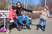 Little cute girls and young mother have fun outdoors — Fotografia Stock