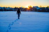 Man walking on deep snowy field — Stock Photo