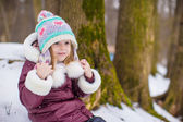 Portrait of cute little girl outdoors on warm winter day — Stock Photo