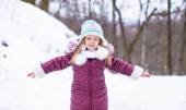 Adorable little happy girl have fun in winter snowy day outdoor — Stock Photo
