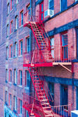 Old houses with stairs in the historic district of West Village — Stock Photo