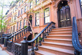 Old houses with stairs in the historic district of West Village — Foto de Stock
