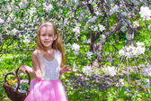 Happy little adorable girl in blossoming apple tree garden — Stock Photo
