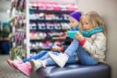 Little girls tired while doing shopping in shopping center — Stock Photo