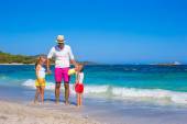 Little girls and happy dad having fun during tropical vacation — Stock Photo