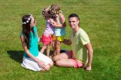 Happy family with two children outdoors on summer day — Stock Photo