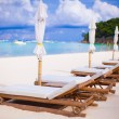 Beach chairs on perfect tropical white sand beach — Stock Photo #66957755