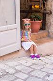 Adorable little girl outdoors in European city — Stock Photo