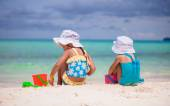 Little girls playing with beach toys during tropical vacation — Stock Photo
