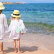 Adorable cute girls have fun on white beach during vacation — Stock Photo #68636221