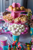 Chocolate cakepops on holiday dessert table at kid birthday party — Stock Photo