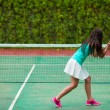 Young sportswoman playing tennis on tropical vacation — Stock Photo #70962839