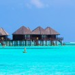 Water villas, bungalows on ideal perfect tropical island — Stock Photo #70968173