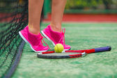 Close up of sneakers near the tennis racquet and ball — Stock Photo