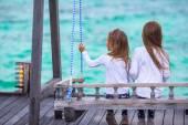 Adorable little girls having fun during beach vacation — Stock fotografie