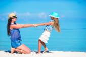 Mother and daughter enjoying time at tropical beach — Stock Photo