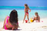 Mother and daughters enjoying time at tropical beach — Stock Photo