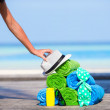 Beach and summer vacation accessories concept - close-up of colorful towels, hat, bag and sunblock — Stock Photo #73288959