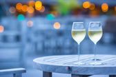 Two glasses of tasty white wine at sunset — Stock Photo