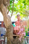 Adorable little girls during beach summer vacation — Stock Photo
