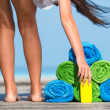 Beach and summer vacation accessories concept - close-up of colorful towels, hat, bag and sunblock — Stock Photo #73292407